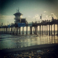 Photo taken at Huntington Beach Pier by Andrea M. on 8/2/2012