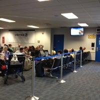 Photo taken at Gate C19 by Alice Y. on 6/7/2012