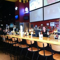 Photo taken at Buffalo Wild Wings Grill & Bar by Justine v. on 2/26/2012