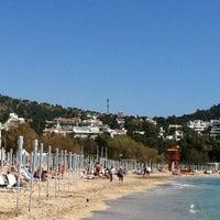 Photo taken at Vouliagmeni Beach by Stelios Z. on 4/1/2012