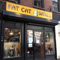 Photo taken at Fat Cat Wine by Caitlin B. on 7/27/2012