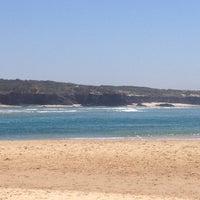 Photo taken at Praia de Vila Nova de Milfontes by Innekepoes on 7/23/2012