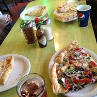 Photo taken at Schmizza Pub & Grub at Tanasbourne by Kyle Y. on 8/12/2012