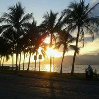 Photo taken at Praia do Perequê by Patty N. on 2/25/2012