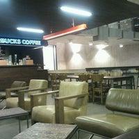 Photo taken at Starbucks by Jeannette L. on 4/13/2012