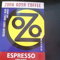 Photo taken at Zona Rosa Caffe by Simple F. on 3/30/2012