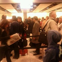 Photo taken at Security/Passport Control - T4 by Dominic L. on 2/21/2012
