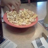 Photo taken at Ninety Nine Restaurant by Annina M. on 7/26/2012