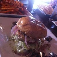 Photo taken at Grind Burger Bar & Lounge by Helen R. on 7/16/2012