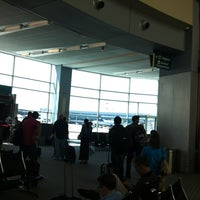 Photo taken at Gate 40 by Wine H. on 6/23/2012