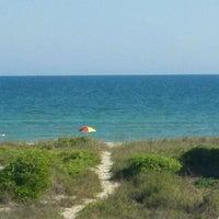 Photo taken at Saint George Island, FL by Travis Y. on 3/17/2012