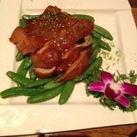 Photo taken at Wild Ginger Pan-Asian Vegan Cafe by Martin R. on 1/23/2012