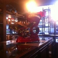 Photo taken at Devotion Cafe Hilton Bogota by Juan S. on 1/20/2012