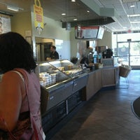 Photo taken at Einstein Bros Bagels by Justin S. on 6/11/2012