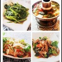 Photo taken at Nine Thai Restaurant by Sandra L. on 7/18/2012