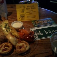 Photo taken at Old Chicago Pizza & Taproom by Mark C. on 12/22/2011