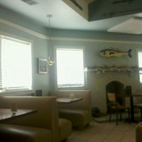 Photo taken at Lures Bar And Grille by Jodi W. on 9/1/2011