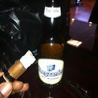 Photo taken at Fume Cigar Shop & Lounge by Lboggiee1 C. on 12/10/2011