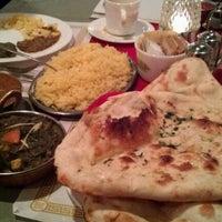 Photo taken at Sangam Indian Restaurant by Adric G. on 12/9/2011