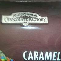 Photo taken at Rocky Mountain Chocolate Factory by Sabin M. on 12/7/2011