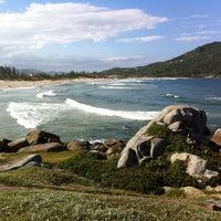 Photo taken at Praia da Ferrugem by Marcelo C. on 2/23/2012
