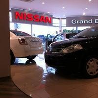Photo taken at Nissan Grand Brasil by Mariana G. on 12/4/2011