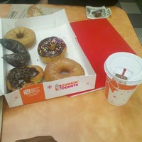 Photo taken at Dunkin' Donuts by T. W. on 2/1/2012