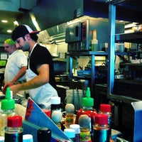 Photo taken at East Coast Grill & Raw Bar by chris h. on 6/27/2011
