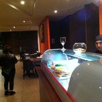 Photo taken at Oishi Sushi by Humberto Q. on 8/20/2011