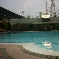 Photo taken at Manyar swimming pool by Dian P. on 2/26/2012