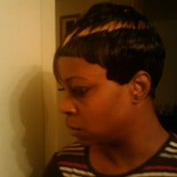 Photo taken at Shear Perfection Hair Salon & Barber/Braiding Shop by Lil-Bit on 1/7/2012