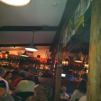 Photo taken at Joe's Beach Road Bar & Grille at The Barley Neck Inn by Carlos N. on 7/24/2012