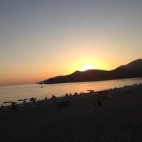Photo taken at Belcekız Plajı by Nesil O. on 8/24/2012