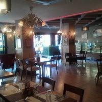 Photo taken at Cajun Cafe & Brasserie by Zeynep U. on 9/16/2011