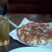 Photo taken at Buono's Pizzeria by Eddie N. on 10/28/2011