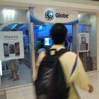 Photo taken at Globe Telecom by Deejhay T. on 1/8/2012