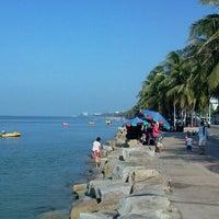 Photo taken at Wonnapa Beach by Thatsaphong F. on 11/26/2011