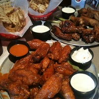 Photo taken at Pluckers Wing Bar by Varinia S. on 4/2/2011