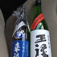 Photo taken at たがみ酒店 by 剛 直. on 3/13/2012