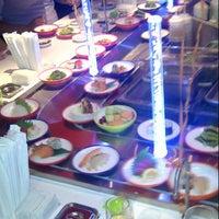 Photo taken at Yo! Sushi by Brendan K. on 7/24/2012