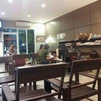 Photo taken at Way Coffee & Bakery by Jakrich U. on 11/10/2011