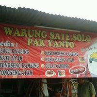 Photo taken at Warung Sate Solo Pak Yanto by Adam T. on 4/6/2012