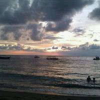 Photo taken at Pantai Senggigi by Amiko R. on 12/13/2011