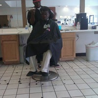 Photo taken at Familiar Faces Barber Shop by Gigi W. on 3/29/2012