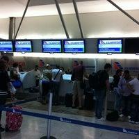 Photo taken at International Departures by Daniela M. on 4/29/2012