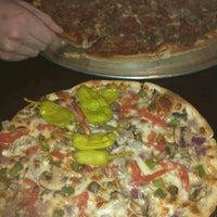 Photo taken at Rochetto's Pizzeria by Laura B. on 2/10/2012