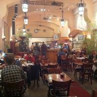 Photo taken at University Cafe by Heather C. on 3/31/2012