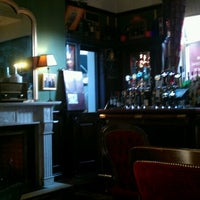 Photo taken at The Library Bar by Paddy O. on 1/9/2012