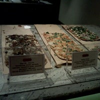 Photo taken at Jules Thin Crust Pizza by Shera S. on 3/8/2012