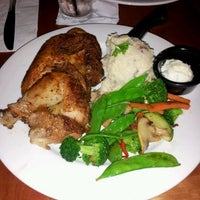Photo taken at Flame Rotisserie Grill & Bar by Mo R. on 6/20/2012